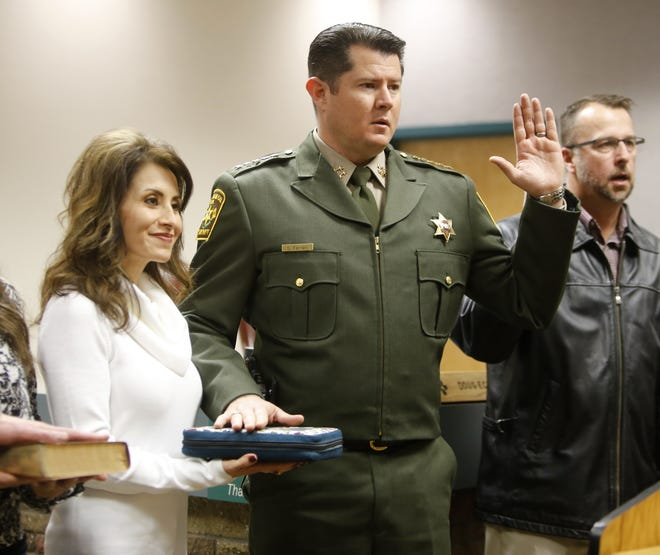 New San Juan County Sheriff Shane Ferrari takes the oath of office Monday in Aztec.