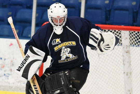 "In summer 2015, then-sports editor Tim Smith — a senior league goaltender for many years — was asked to do a ""day in the life"" story about how young goalie prospects are put through their paces against college and pro shooters during a Bandits Pro Elite Goalie Camp at USA Hockey Arena in Plymouth. That experience remains at the top of personal favorites generated during a 33-year career with the Observer & Eccentric."