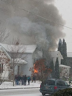 Oshkosh Fire Department crews respond to a house fire on the 600 block of Otter Avenue Monday afternoon.