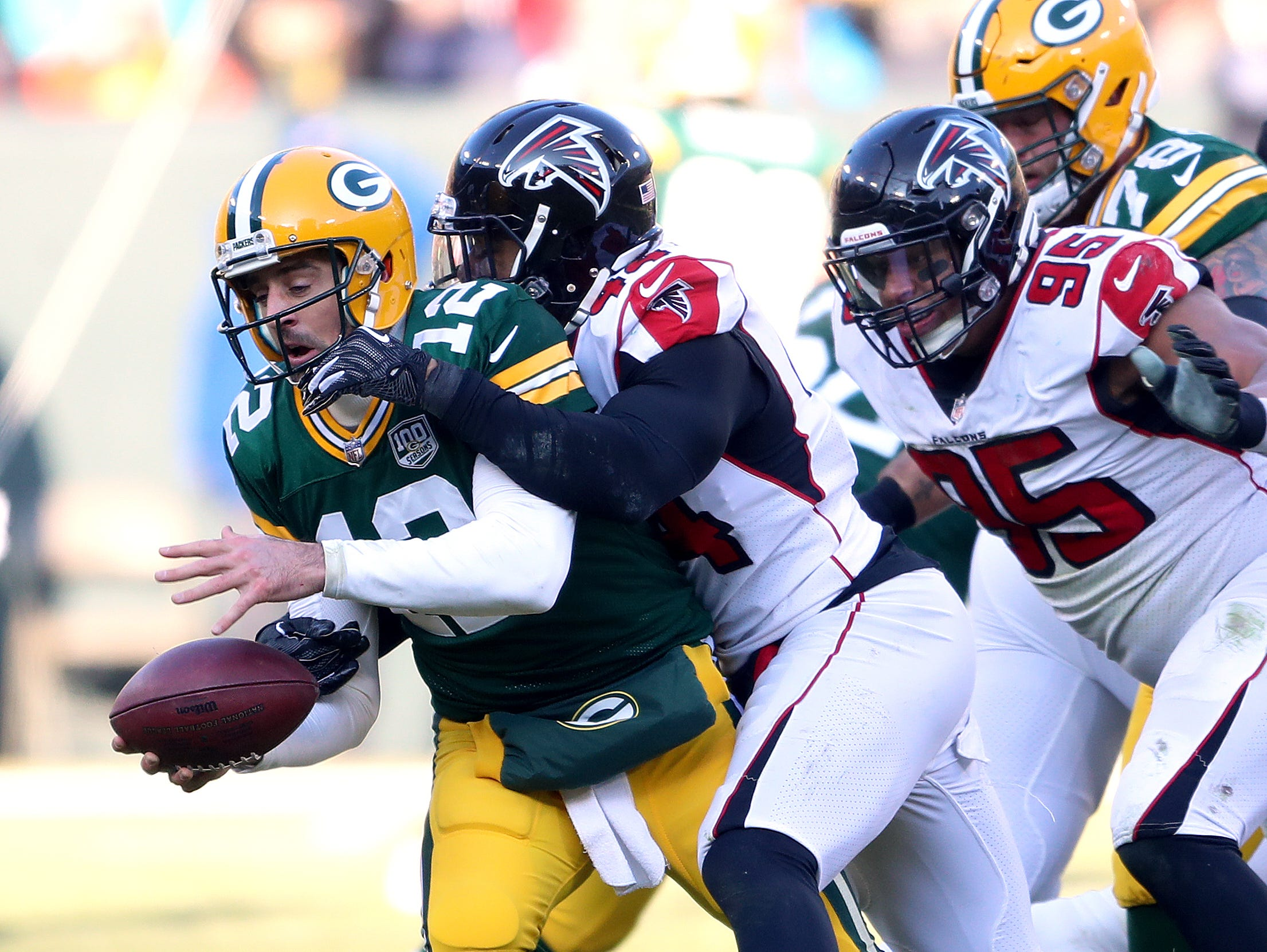 Green Bay Packers quarterback Aaron Rodgers (12) gets sacked by defensive end Vic Beasley (44) against the Atlanta Falcons Sunday, December 9, 2018 at Lambeau Field in Green Bay, Wis. Jim Matthews/USA TODAY NETWORK-Wis