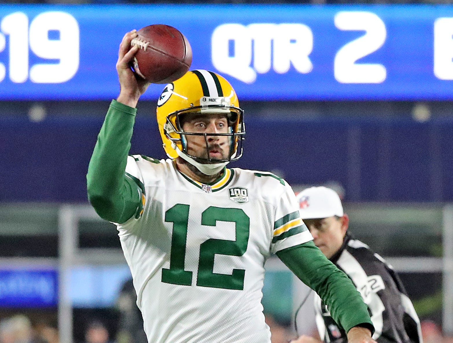 Green Bay Packers quarterback Aaron Rodgers (12) pump fakes on a a run against the New England Patriots Sunday, November 4, 2018 at Gillette Stadium in Foxboro, Mass.
