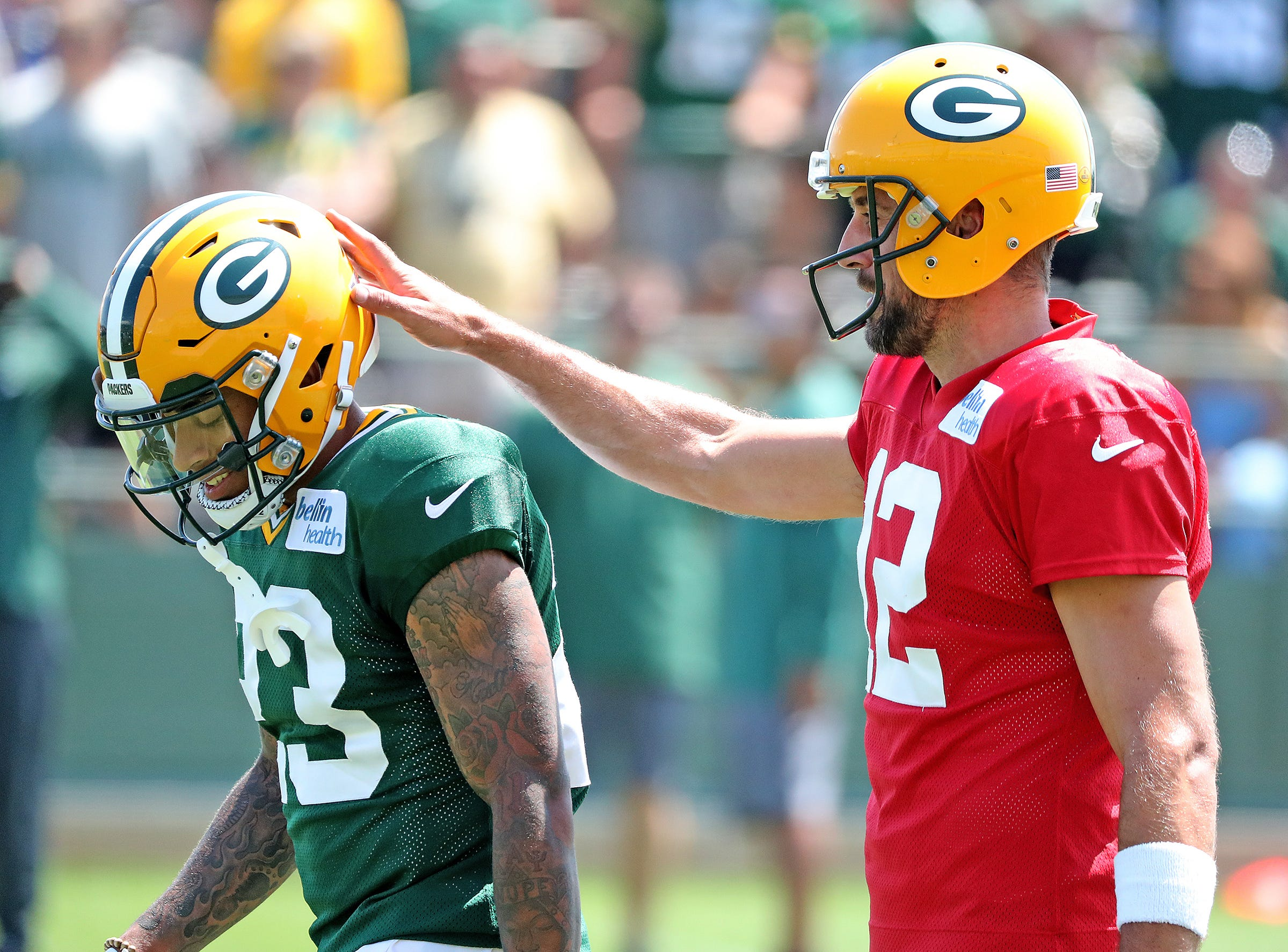 Green Bay Packers quarterback Aaron Rodgers (12) gives cornerback Jaire Alexander (23) and encouraging pat on the helmet during Green Bay Packers Training Camp Saturday, July 28, 2018 at Ray Nitschke Field in Ashwaubenon, Wis