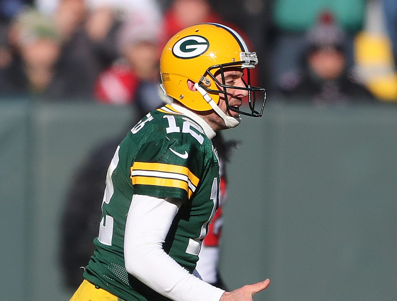 Green Bay Packers quarterback Aaron Rodgers (12) complains to the  officials that his helmet was grabbed on a tackle against the Atlanta Falcons Sunday, December 9, 2018 at Lambeau Field in Green Bay, Wis. Jim Matthews/USA TODAY NETWORK-Wis