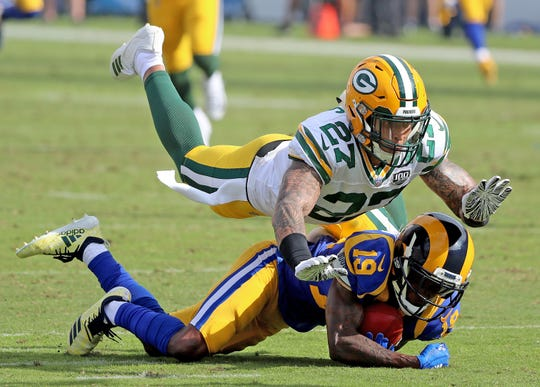 Green Bay Packers defensive back Josh Jones (27) drops punt returner wide receiver JoJo Natson (19) against the LA Rams Sunday, October 28, 2018 at the Memorial Coliseum in Los Angeles, Cal. Jim Matthews/USA TODAY NETWORK-Wis