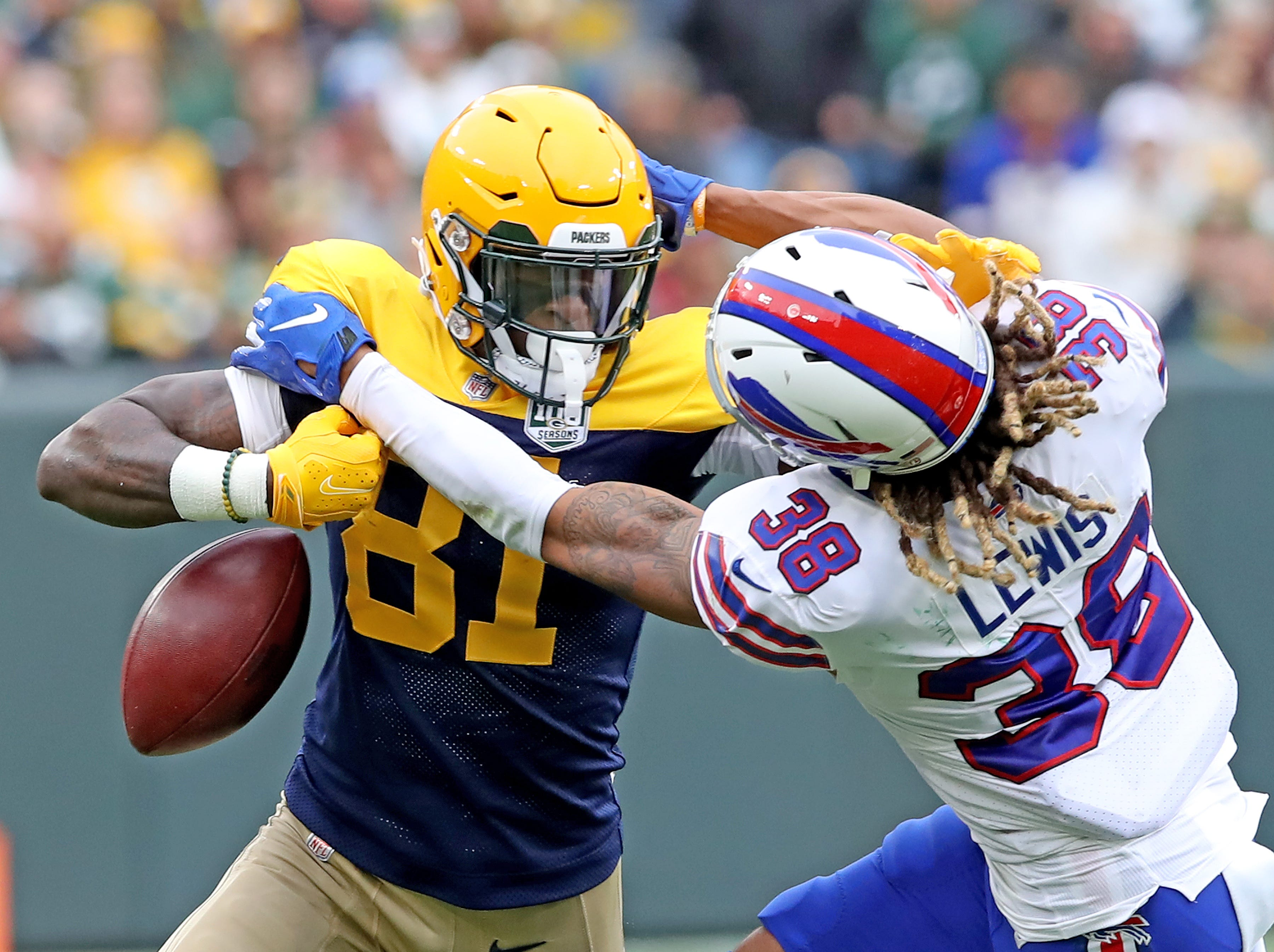 Green Bay Packers wide receiver Geronimo Allison (81) has the ball knocked loose by defensive back Ryan Lewis (38) against the Buffalo Bills Sunday September 30, 2018 at Lambeau Field in Green Bay, Wis.