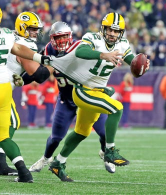 9dec63e49 Green Bay Packers quarterback Aaron Rodgers (12) is grabbed by his jersey on  a