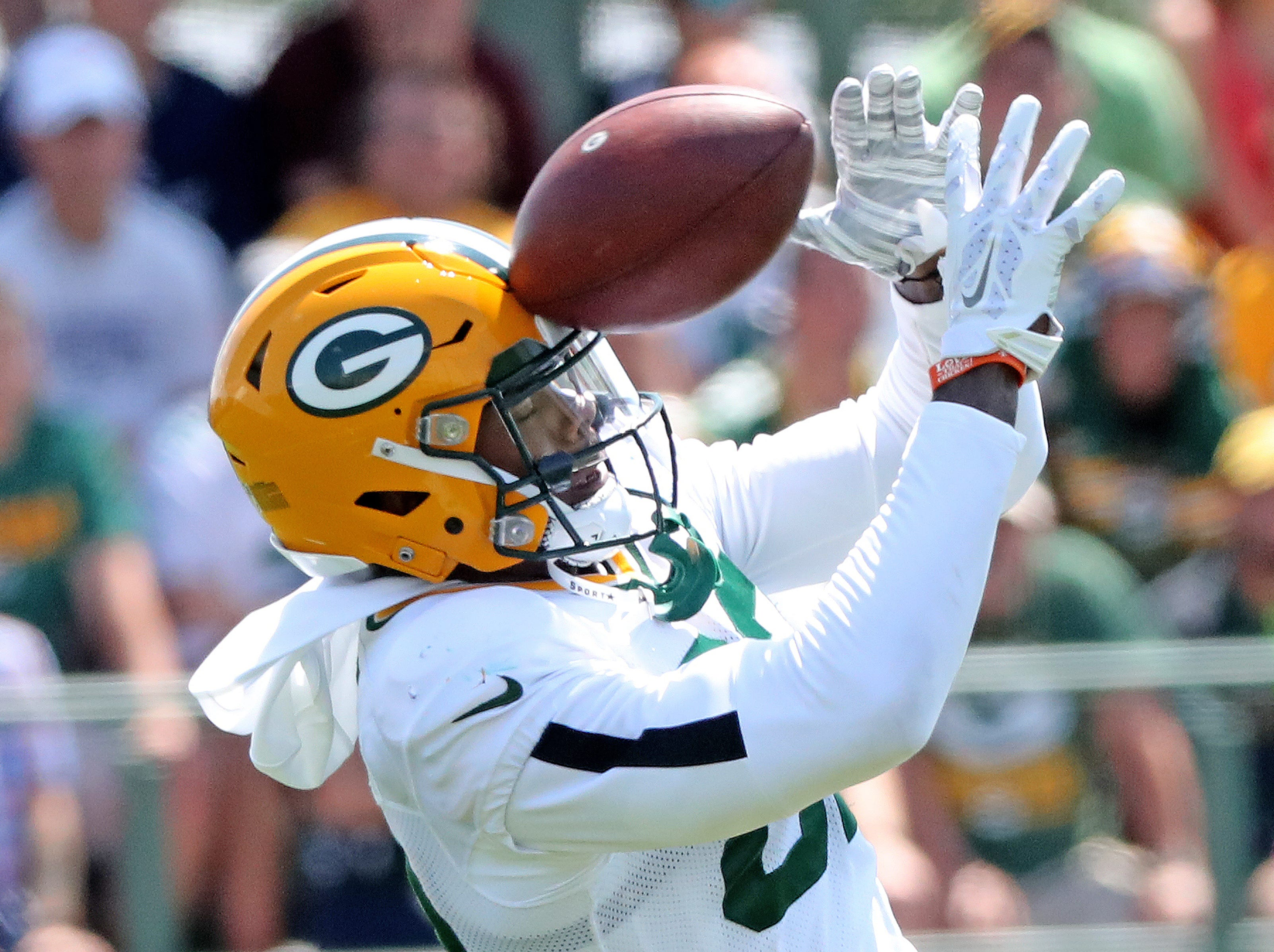 Green Bay Packers wide receiver J'Mon Moore (82) takes one to the forehead during Green Bay Packers Training Camp Saturday, July 28, 2018 at Ray Nitschke Field in Ashwaubenon, Wis