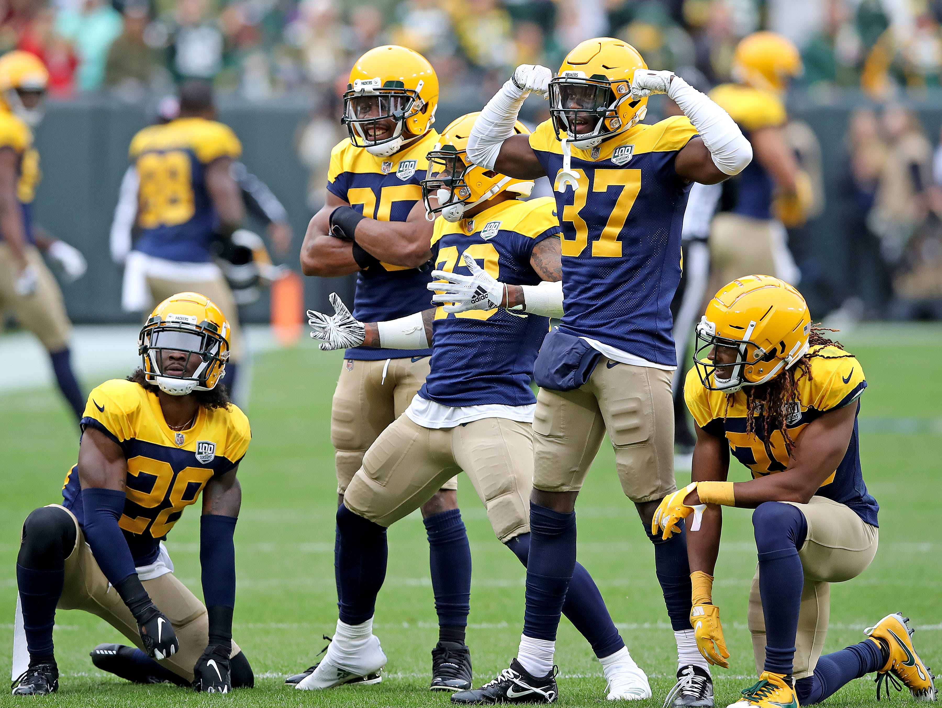 Green Bay Packers cornerback Jaire Alexander (23) and the rest of the defensive backfield celebrates his interception against the Buffalo Bills Sunday September 30, 2018 at Lambeau Field in Green Bay, Wis.
