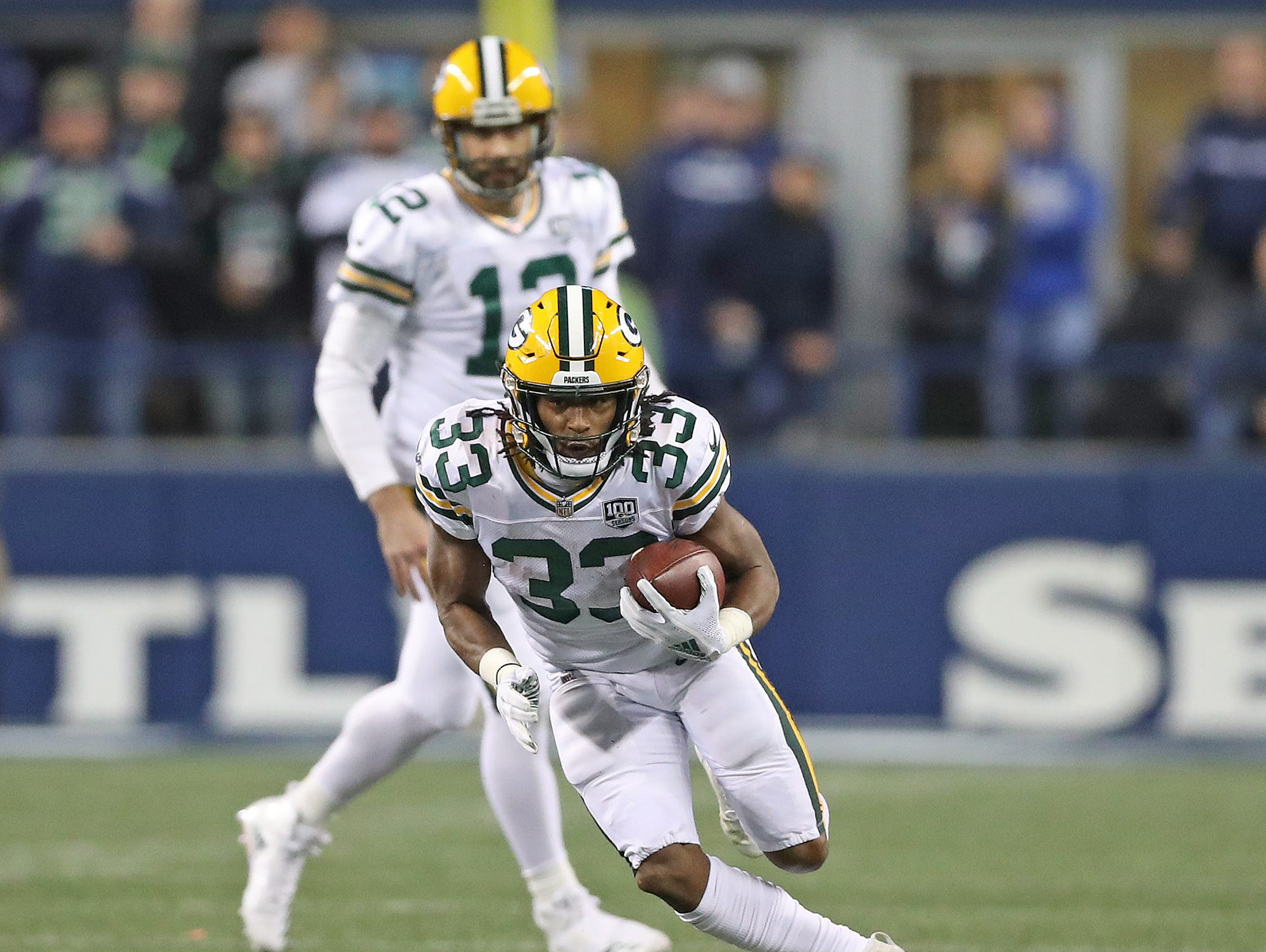 Green Bay Packers running back Aaron Jones (33) runs the ball against the Seattle Seahawks at CenturyLink Field Thursday, November 15, 2018 in Seattle, WA. Jim Matthews/USA TODAY NETWORK-Wis