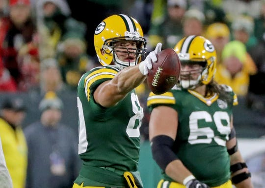Green Bay Packers tight end Jimmy Graham (80) signals a first down against the San Francisco 49ers at Lambeau Field Monday, October 15, 2018 in Green Bay, Wis.