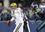 Green Bay Packers quarterback Aaron Rodgers (12) signals to a receiver as he scrambles right against the Seattle Seahawks at CenturyLink Field Thursday, November 15, 2018 in Seattle, WA. Jim Matthews/USA TODAY NETWORK-Wis