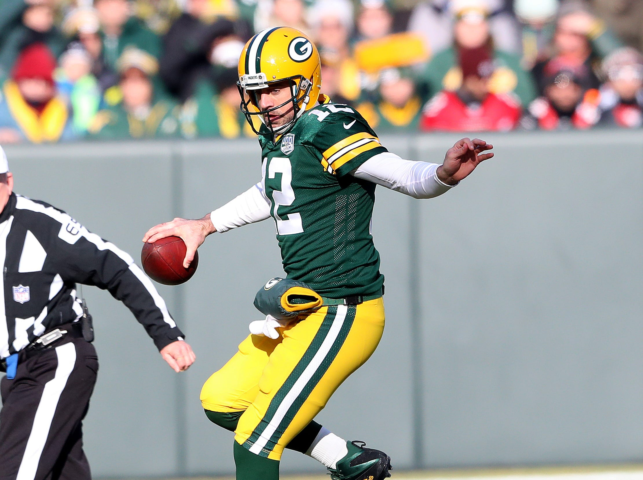 Green Bay Packers quarterback Aaron Rodgers (12) leaps past a tackle attempt against the Atlanta Falcons Sunday, December 9, 2018 at Lambeau Field in Green Bay, Wis. Jim Matthews/USA TODAY NETWORK-Wis
