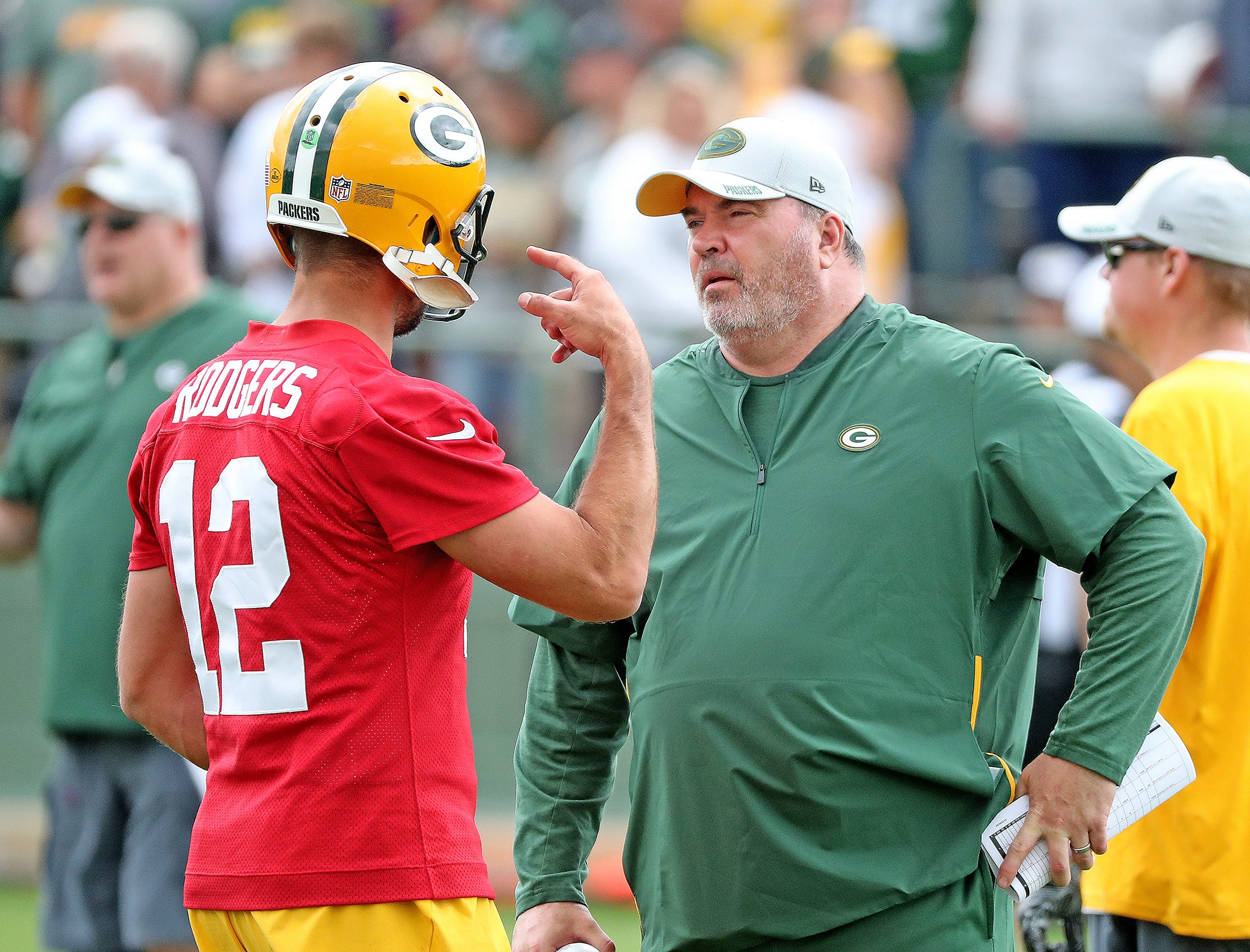 Green Bay Packers quarterback Aaron Rodgers (12) talks with head coach Mike McCarthy during Green Bay Packers Training Camp Friday, July 27, 2018 at Ray Nitschke Field in Ashwaubenon, Wis