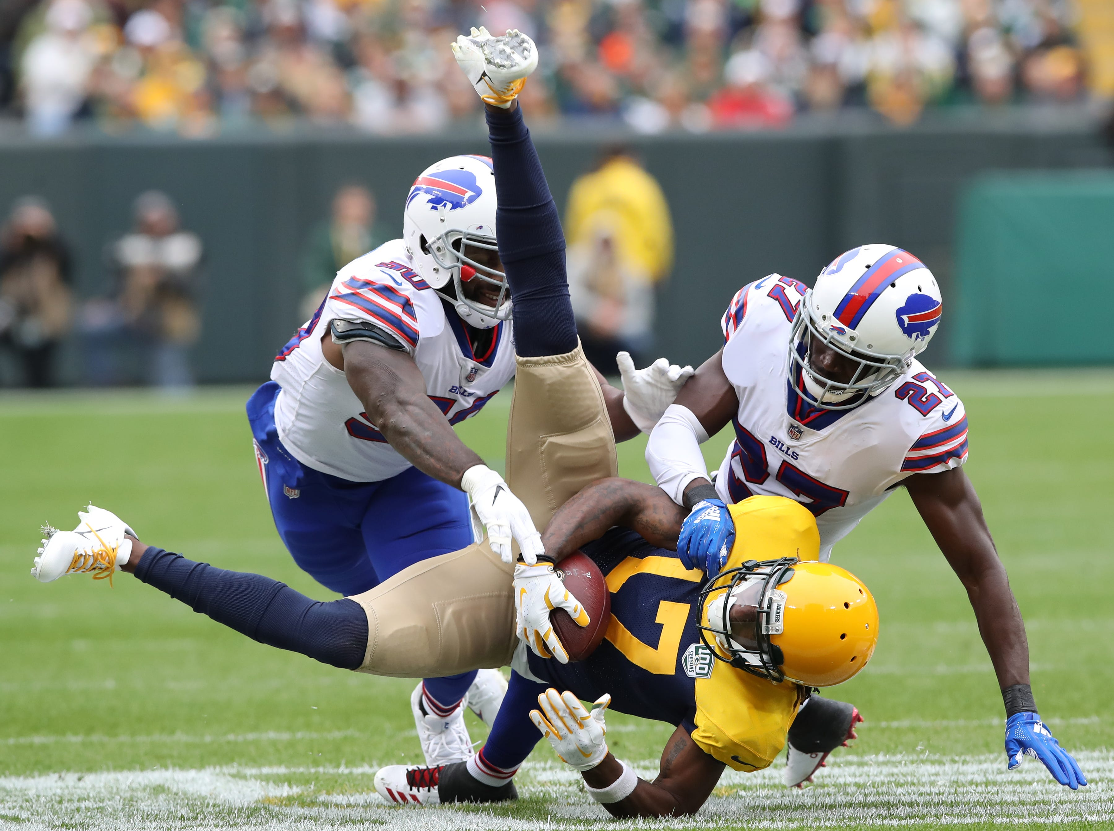 Green Bay Packers wide receiver Davante Adams (17) gets flipped while being tackled against the Buffalo Bills Sunday September 30, 2018 at Lambeau Field in Green Bay, Wis.