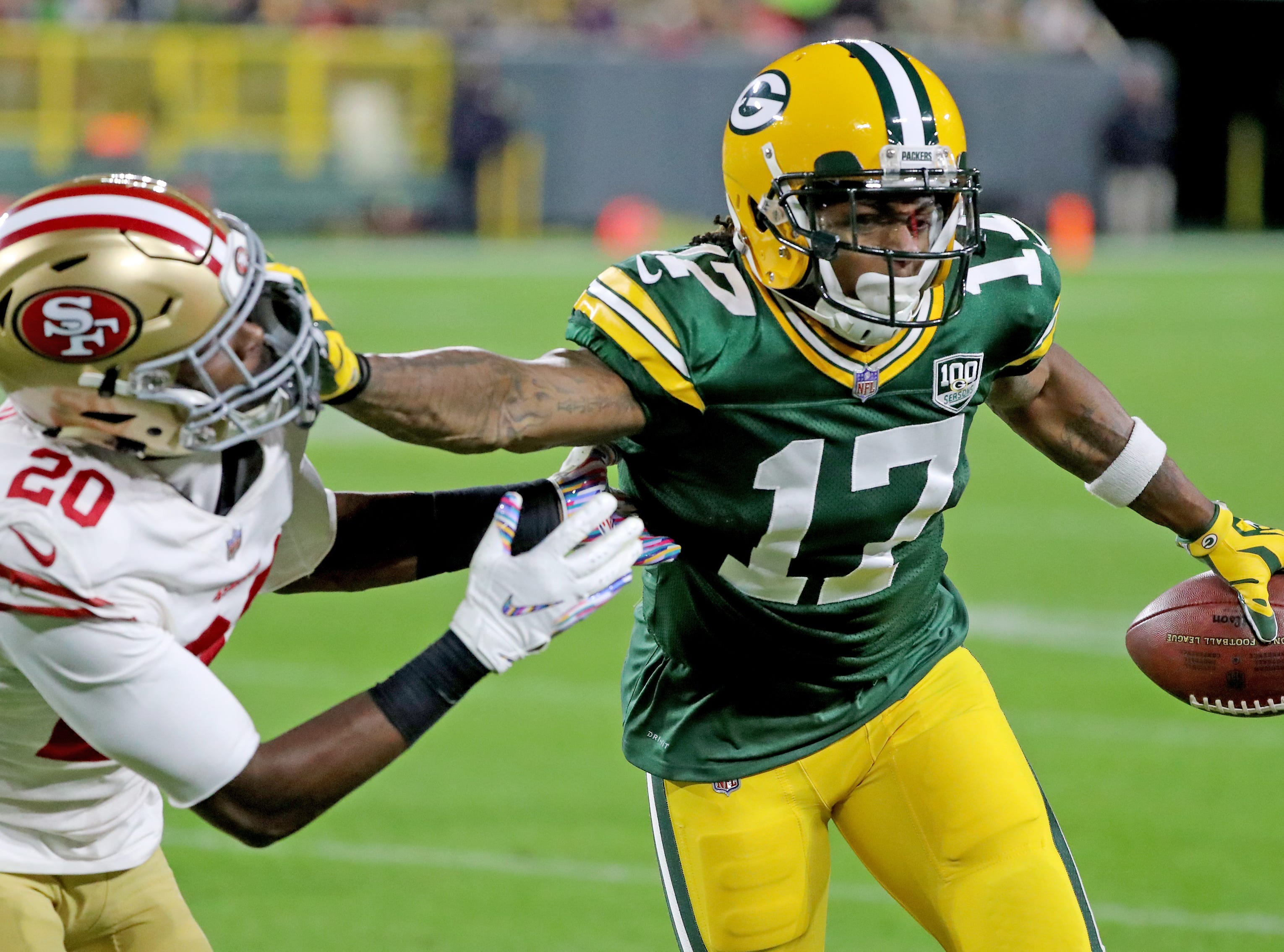 Green Bay Packers wide receiver Davante Adams (17) stiff arms cornerback Jimmie Ward (20) against the San Francisco 49ers at Lambeau Field Monday, October 15, 2018 in Green Bay, Wis.