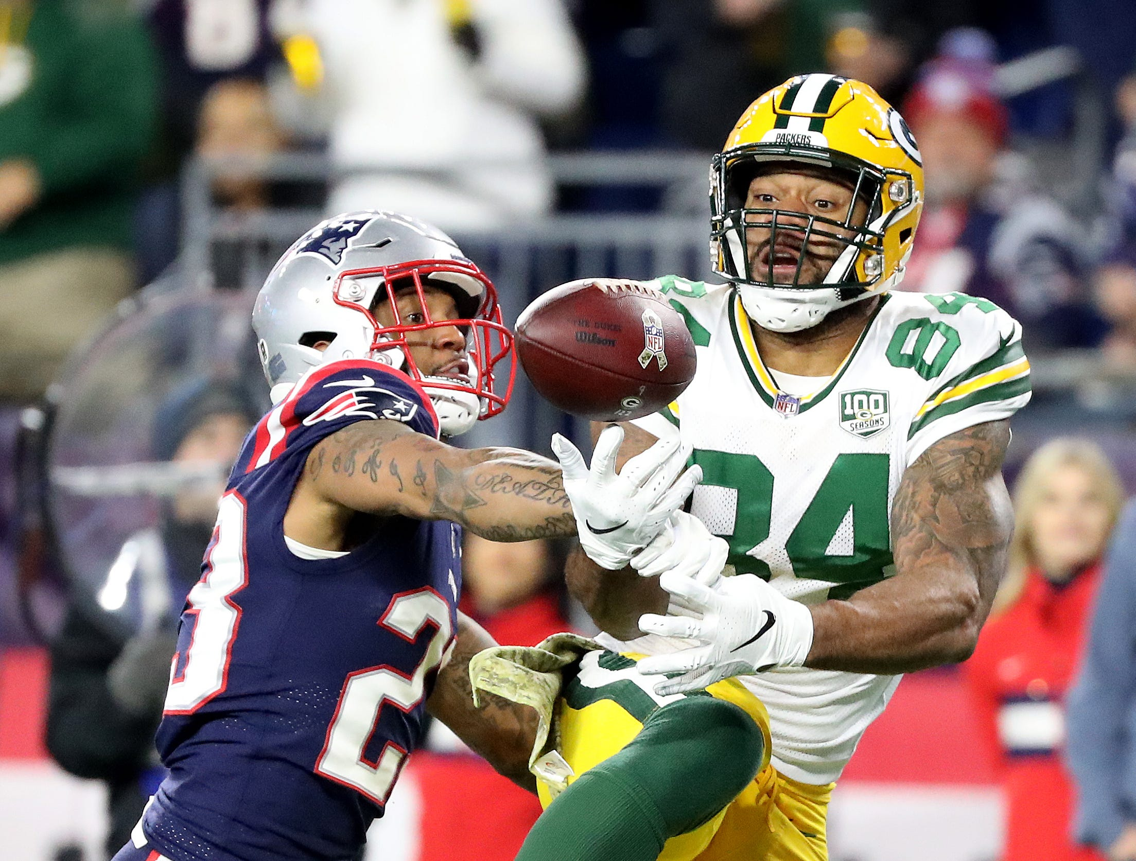 Green Bay Packers tight end Lance Kendricks (84) can't find the handle on a pass in the end zone against the New England Patriots Sunday, November 4, 2018 at Gillette Stadium in Foxboro, Mass.