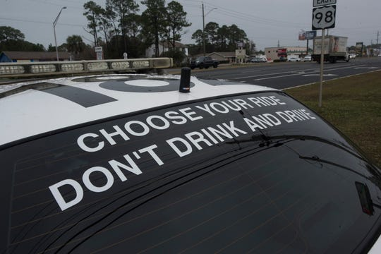 """""""Due to its extremely unusual appearance, it draws attention. And it draws attention to the fact that you can choose a ride— either in a taxi or the back of a police car,"""" said Santa Rosa County Sheriff's Office spokesman Rich Aloy of the half-taxi, half-patrol car the SRSO parked in Navarre ahead of New Year's Eve."""