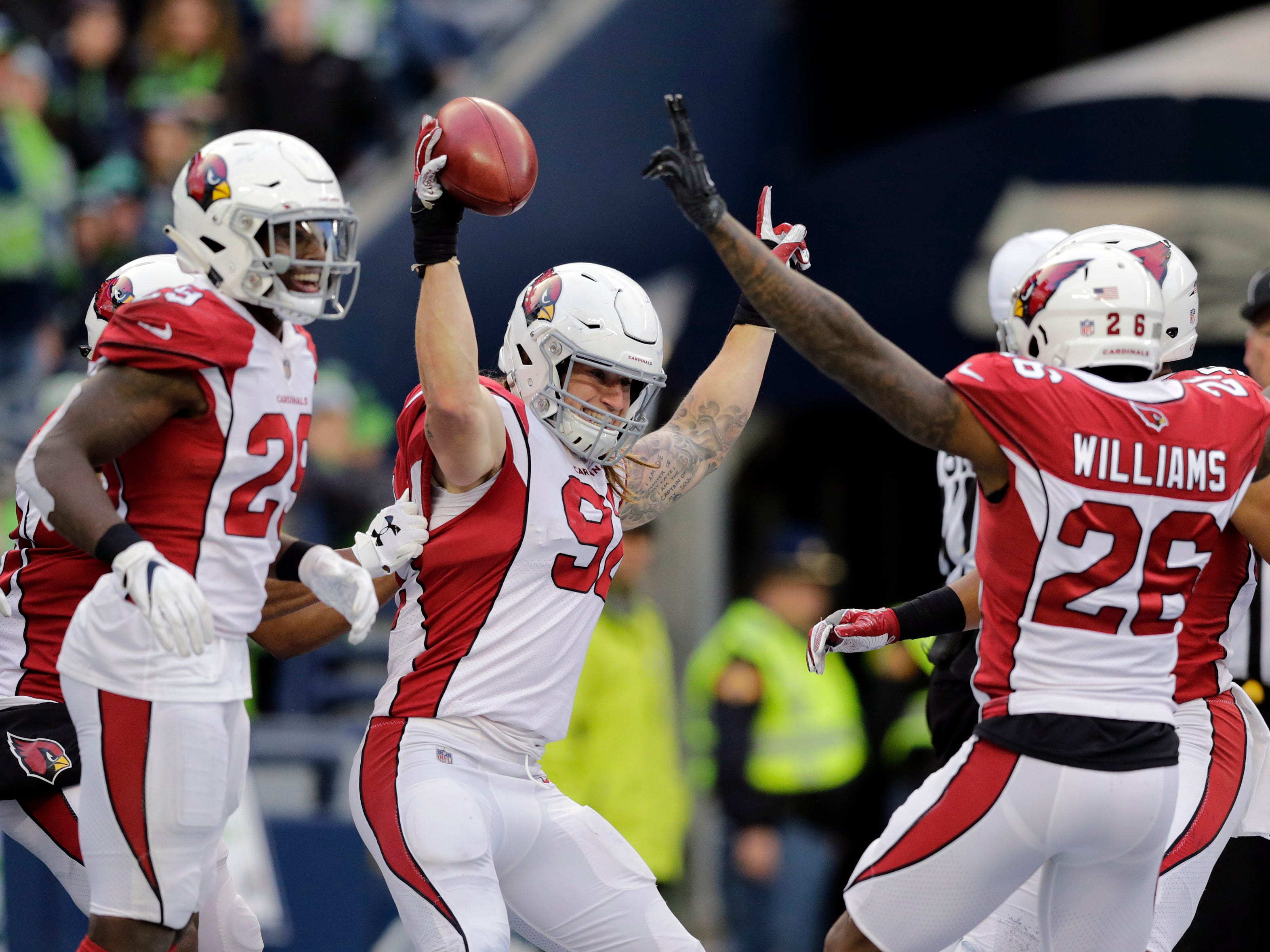 Arizona Cardinals' Dennis Gardeck (92) celebrates with teammates after recovering a blocked kick in the end zone to score a touchdown against the Seattle Seahawks during the second half of an NFL football game, Sunday, Dec. 30, 2018, in Seattle. (AP Photo/John Froschauer)