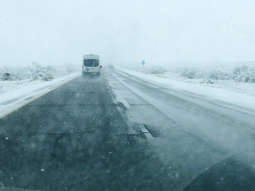 Snow fell throughout northern Arizona on New Year's Eve causing hazardous road conditions and delays.