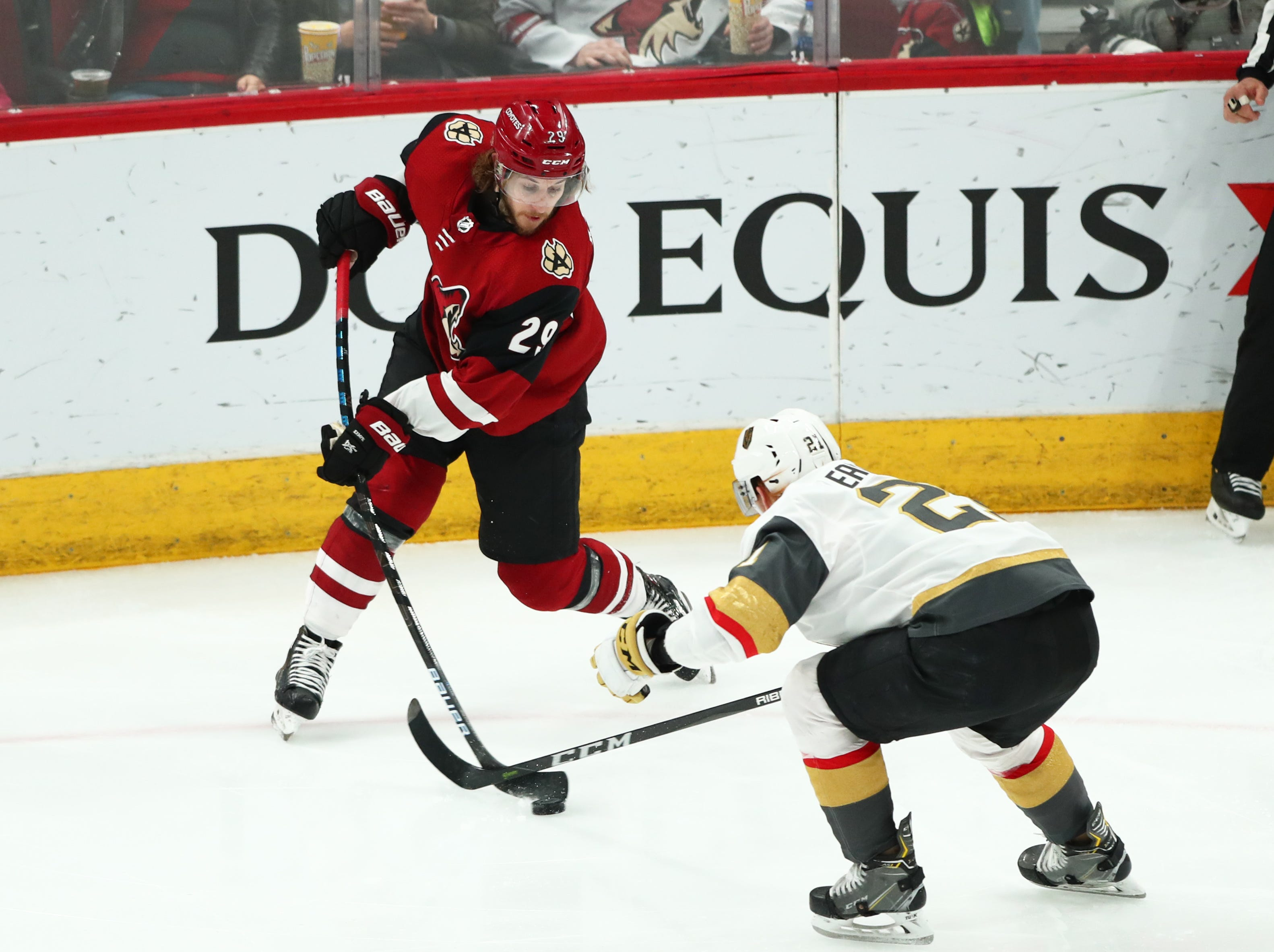 Dec 30, 2018; Glendale, AZ, USA; Arizona Coyotes right wing Mario Kempe (29) moves the puck against Vegas Golden Knights center Cody Eakin (21) in the second period at Gila River Arena. Mandatory Credit: Mark J. Rebilas-USA TODAY Sports