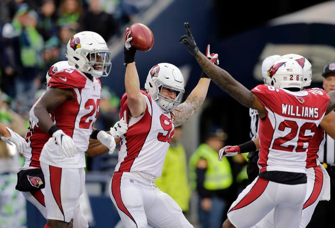 Arizona Cardinals' Dennis Gardeck (92) celebrates with teammates after recovering a blocked kick in the end zone to score a touchdown against the Seattle Seahawks during the second half of an NFL football game, Sunday, Dec. 30, 2018, in Seattle.