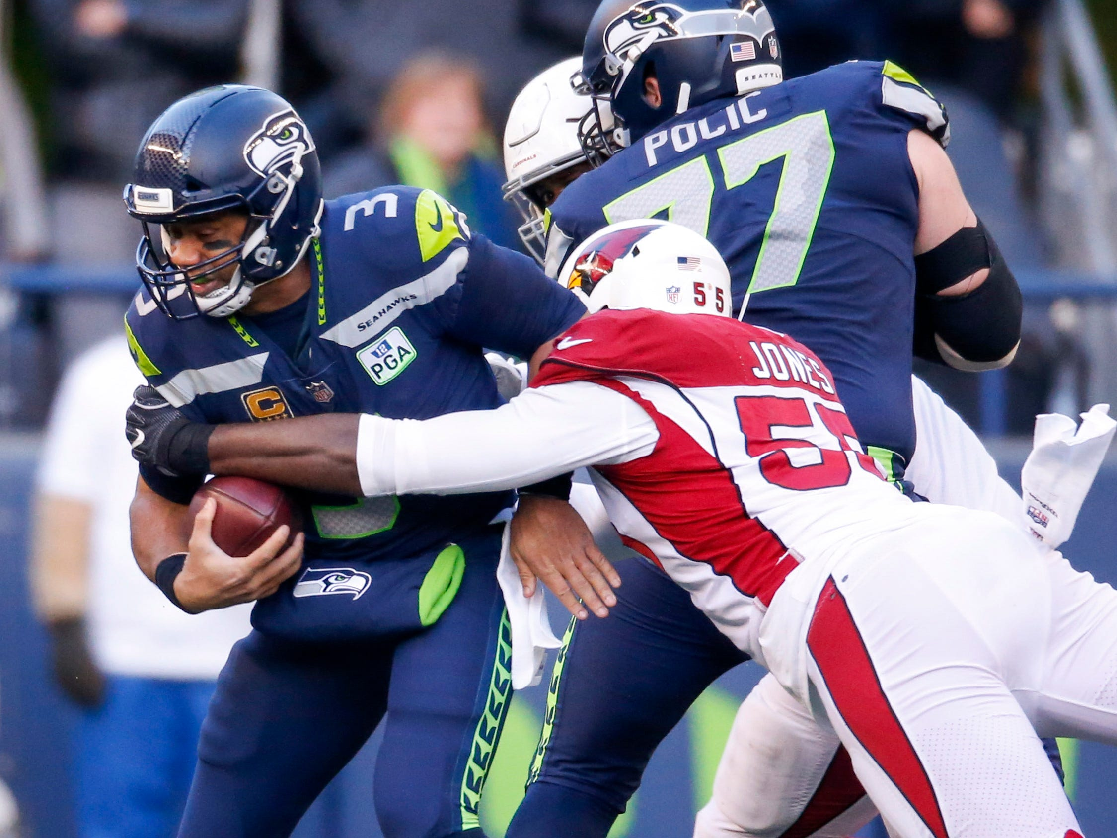 Dec 30, 2018; Seattle, WA, USA; Arizona Cardinals defensive end Chandler Jones (55) sacks Seattle Seahawks quarterback Russell Wilson (3) during the second quarter at CenturyLink Field. Mandatory Credit: Joe Nicholson-USA TODAY Sports