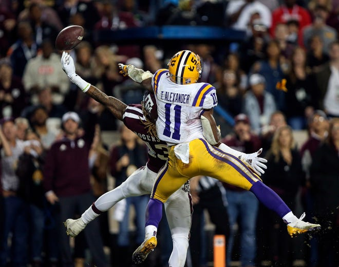Nov 24, 2018: Texas A&M Aggies wide receiver Kendrick Rogers (13) makes a reception for a touchdown as LSU Tigers cornerback Terrence Alexander (11) defends during the third overtime at Kyle Field.
