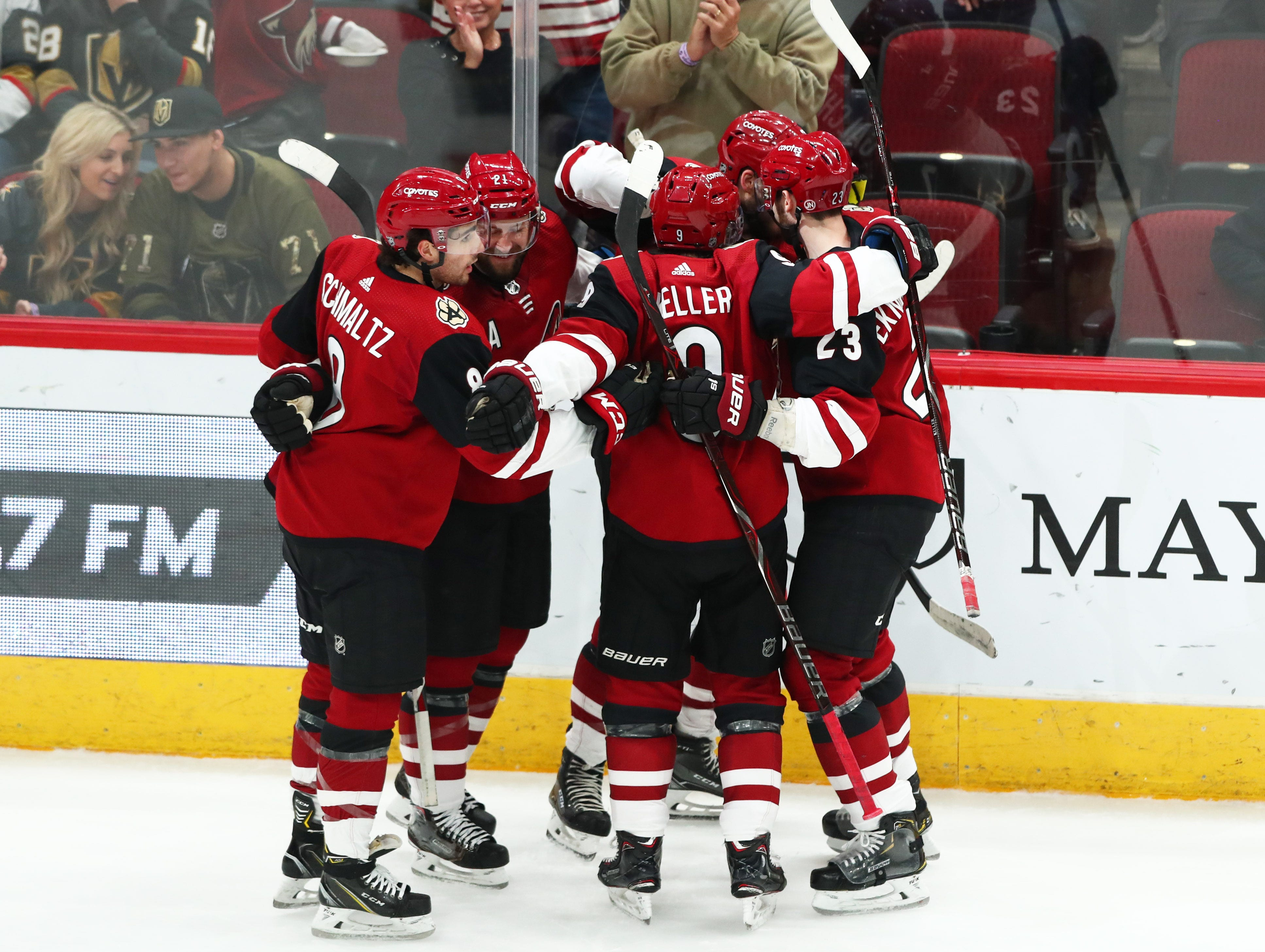 Dec 30, 2018; Glendale, AZ, USA; Arizona Coyotes center Alex Galchenyuk (17) celebrates with teammates after scoring a second period goal against the Vegas Golden Knights at Gila River Arena. Mandatory Credit: Mark J. Rebilas-USA TODAY Sports
