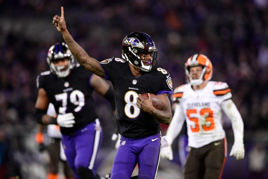 Ravens quarterback Lamar Jackson runs with the ball during the second half of a game against the Browns at M&T Bank Stadium.