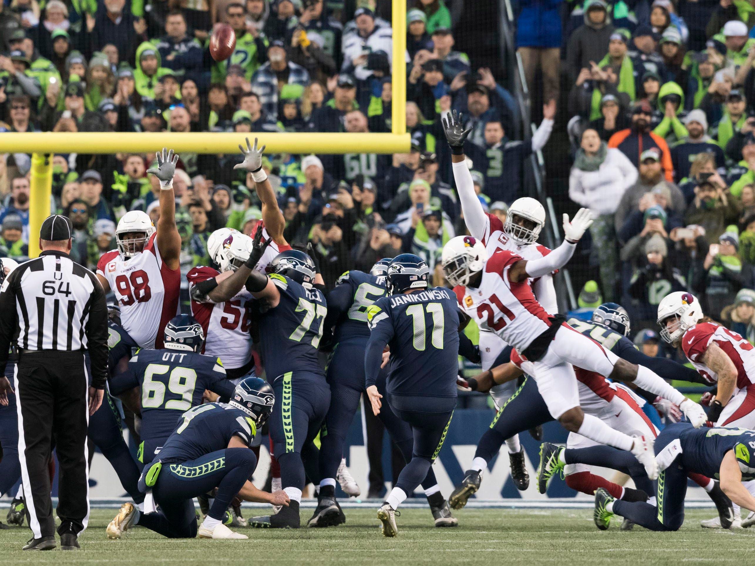 Dec 30, 2018; Seattle, WA, USA; Seattle Seahawks kicker Sebastian Janikowski (11) kicks the game winning field goal against the Arizona Cardinals during the second half at CenturyLink Field. Seattle defeated Arizona 27-24. Mandatory Credit: Steven Bisig-USA TODAY Sports