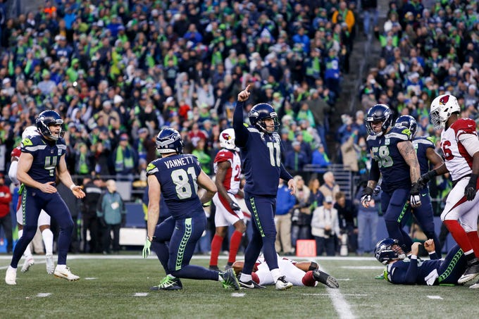 Dec 30, 2018; Seattle, WA, USA; Seattle Seahawks kicker Sebastian Janikowski (11) celebrates after kicking a game-winning field goal as time expires against the Arizona Cardinals during the fourth quarter at CenturyLink Field. Seattle Seahawks holder Michael Dickson (4) reacts at left. Mandatory Credit: Joe Nicholson-USA TODAY Sports