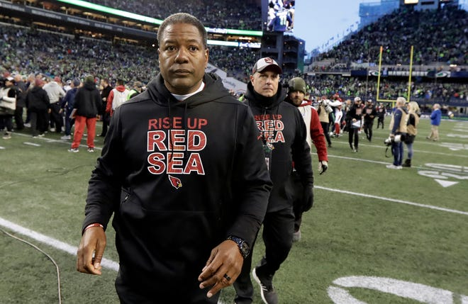 Arizona Cardinals head coach Steve Wilks walks off the field after an NFL football game against the Seattle Seahawks, Sunday, Dec. 30, 2018, in Seattle. The Seahawks won 27-24.