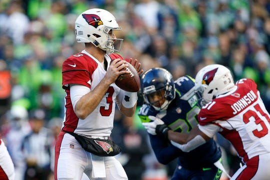 Dec 30, 2018; Seattle, WA, USA; Arizona Cardinals quarterback Josh Rosen (3) looks to pass against the Seattle Seahawks during the first quarter at CenturyLink Field. Mandatory Credit: Joe Nicholson-USA TODAY Sports