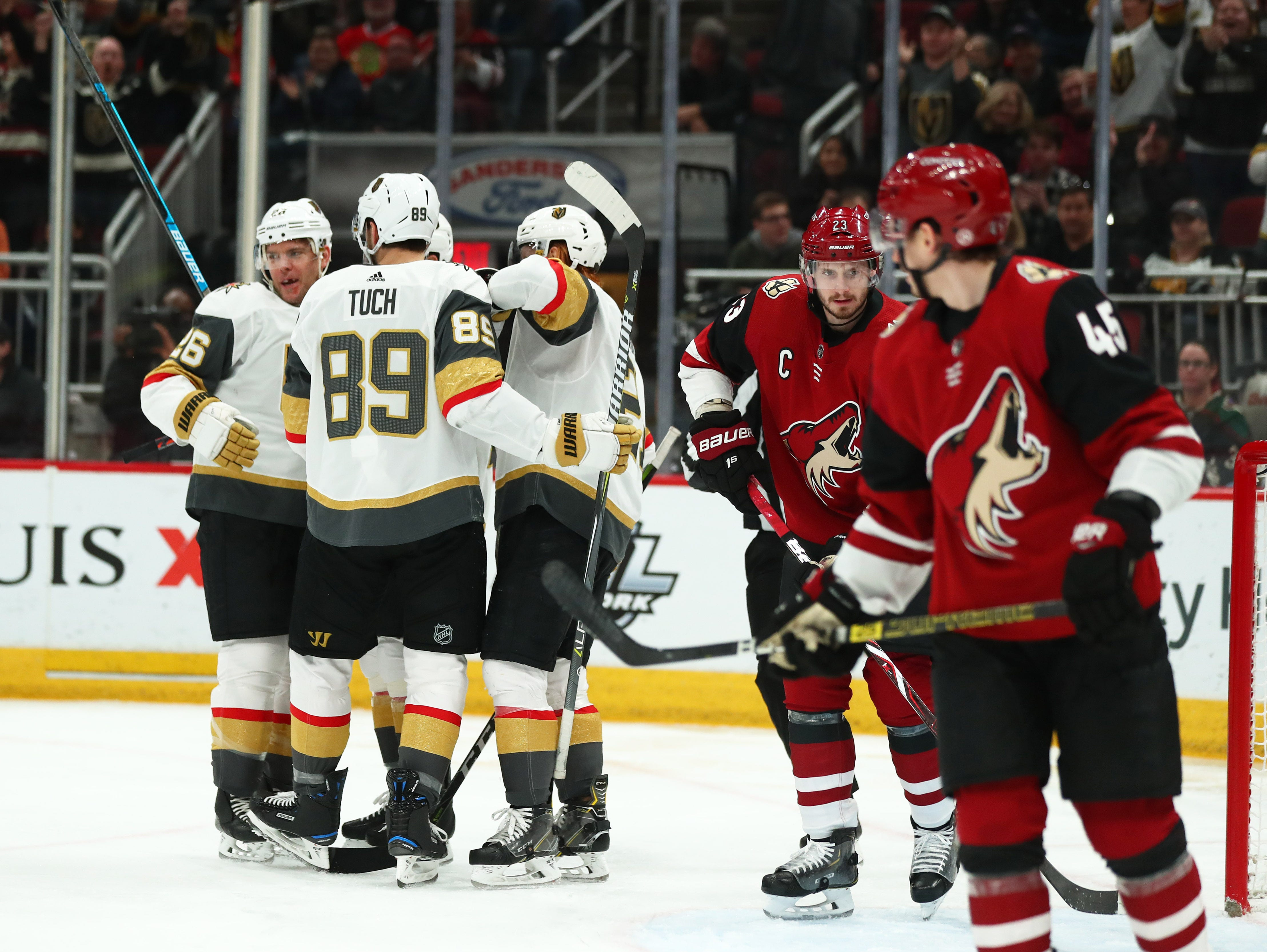 Dec 30, 2018; Glendale, AZ, USA; Vegas Golden Knights center Paul Stastny (26) celebrates with teammates after scoring a first period goal against the Arizona Coyotes at Gila River Arena. Mandatory Credit: Mark J. Rebilas-USA TODAY Sports