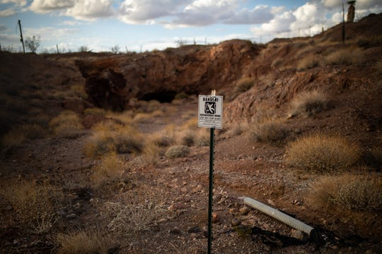 """A sign outside of an abandoned mine about 40 minutes west of Kingman reads, """"Danger! Abandoned mine stay out! Stay Alive!"""" Damaging or removing signs such as these is a felony in Arizona."""