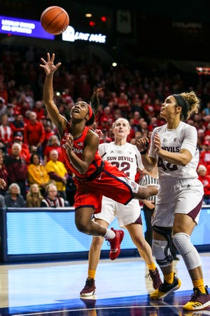 Arizona Wildcats guard Aarion McDonald (2) lays up the ball during a college women's basketball game between the Arizona State Sun Devils and the Arizona Wildcats on December 30, 2018, at McKale Center in Tucson, AZ.
