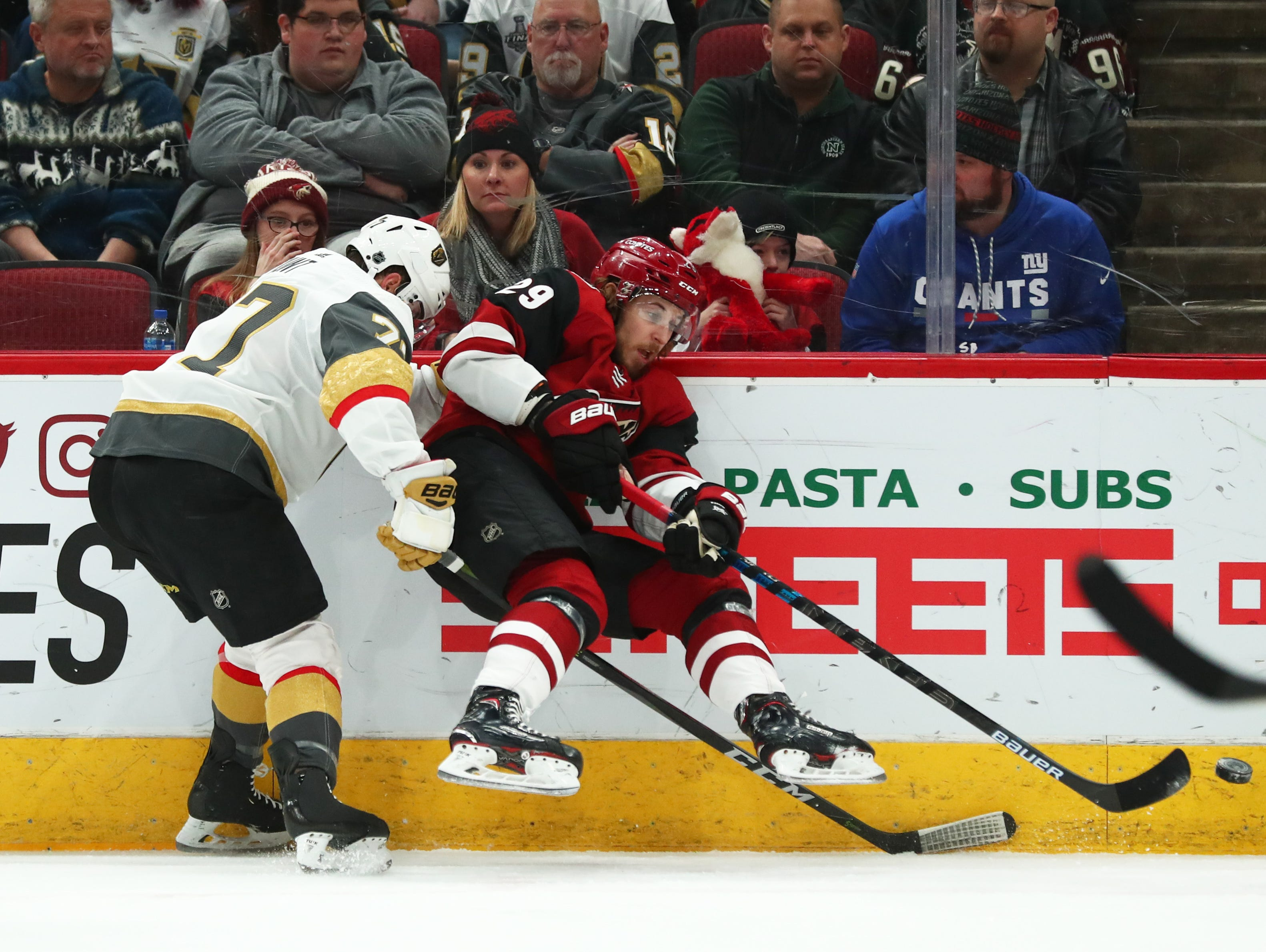 Dec 30, 2018; Glendale, AZ, USA; Arizona Coyotes right wing Mario Kempe (29) moves the puck against Vegas Golden Knights defenseman Brad Hunt (77) in the first period at Gila River Arena. Mandatory Credit: Mark J. Rebilas-USA TODAY Sports
