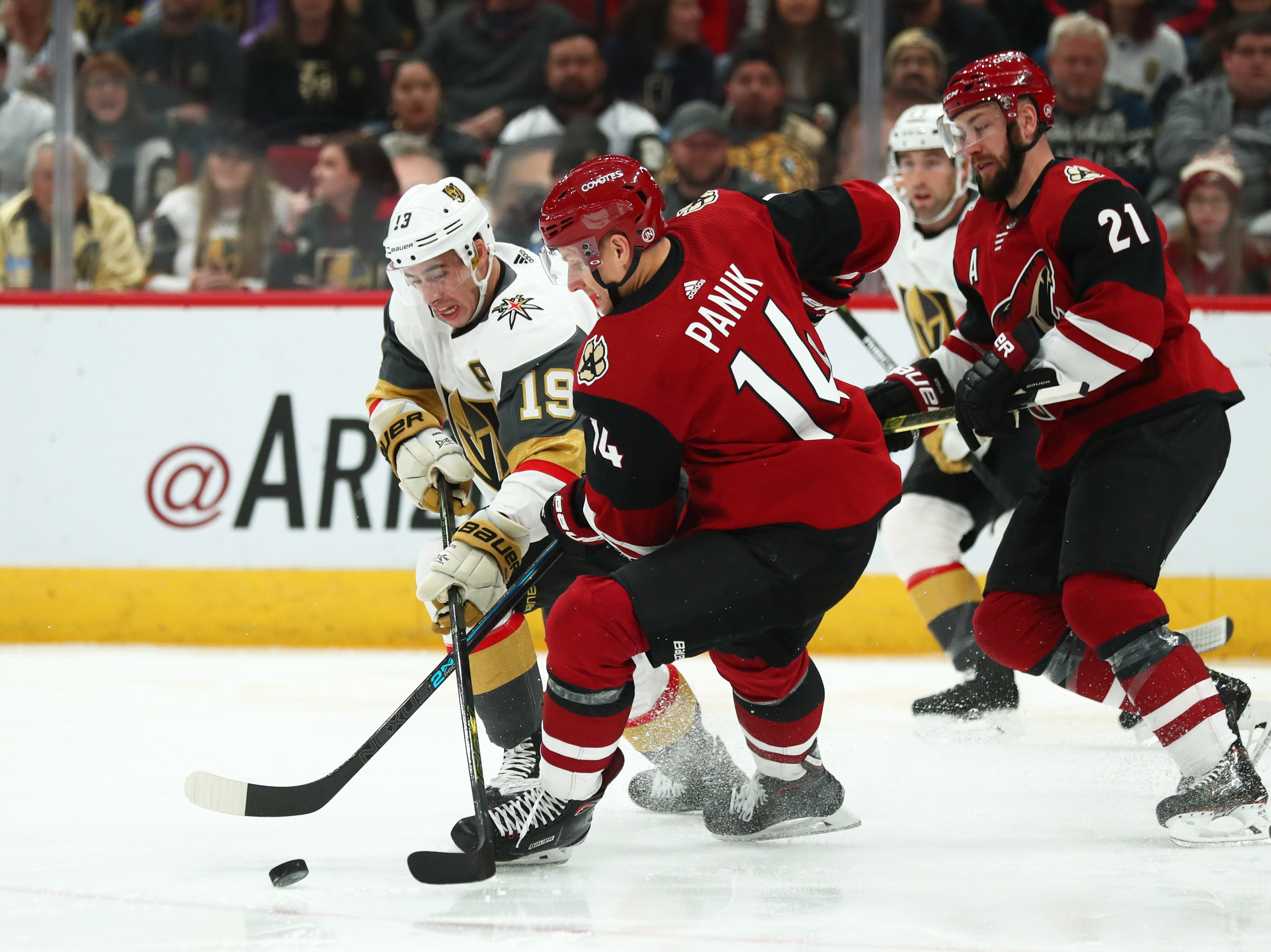 Dec 30, 2018; Glendale, AZ, USA; Arizona Coyotes right wing Richard Panik (14) against Vegas Golden Knights right wing Reilly Smith (19) in the first period at Gila River Arena. Mandatory Credit: Mark J. Rebilas-USA TODAY Sports