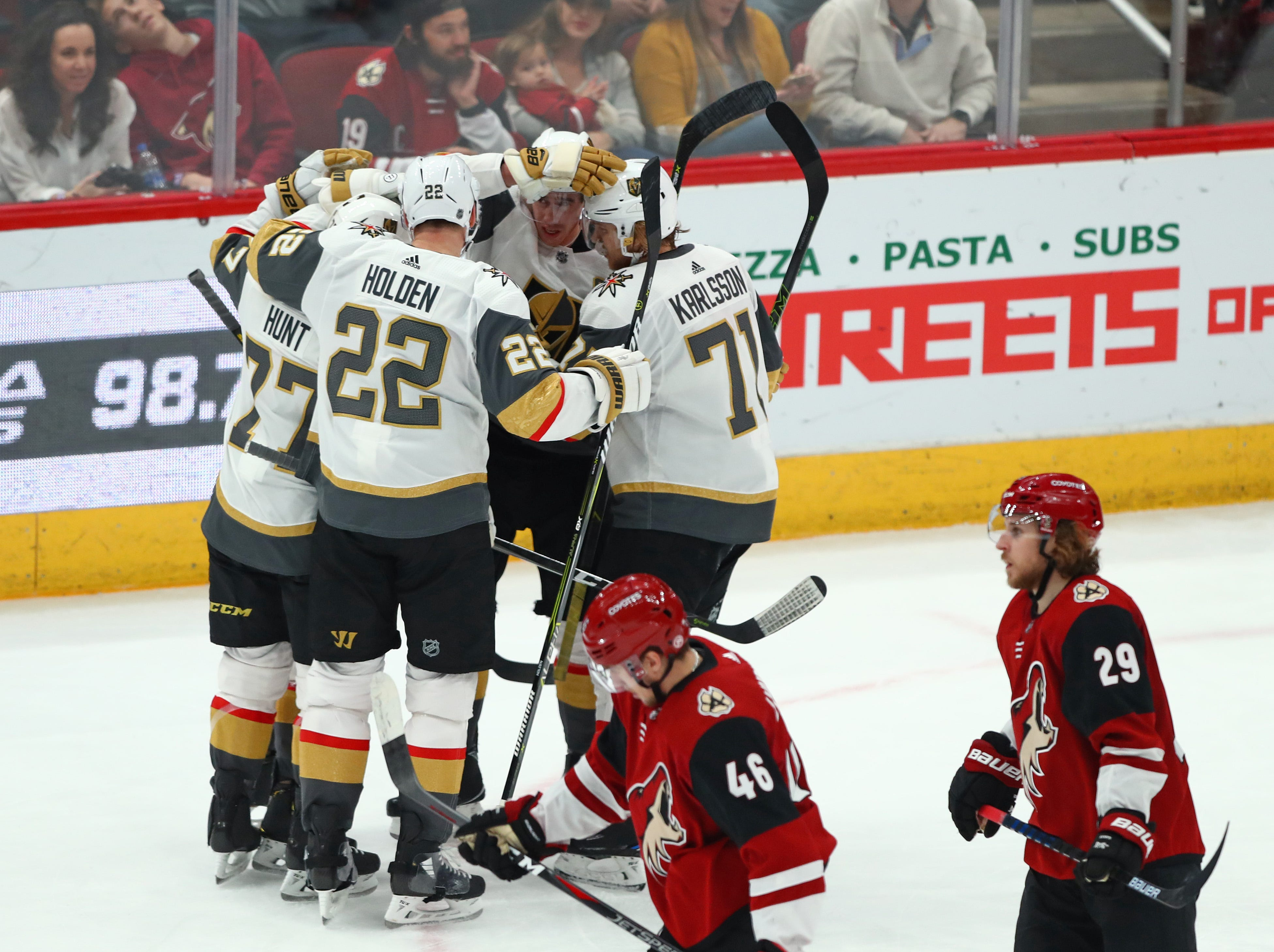 Dec 30, 2018; Glendale, AZ, USA; Vegas Golden Knights right wing Reilly Smith (19) celebrates a second period goal with teammates against the Arizona Coyotes at Gila River Arena. Mandatory Credit: Mark J. Rebilas-USA TODAY Sports