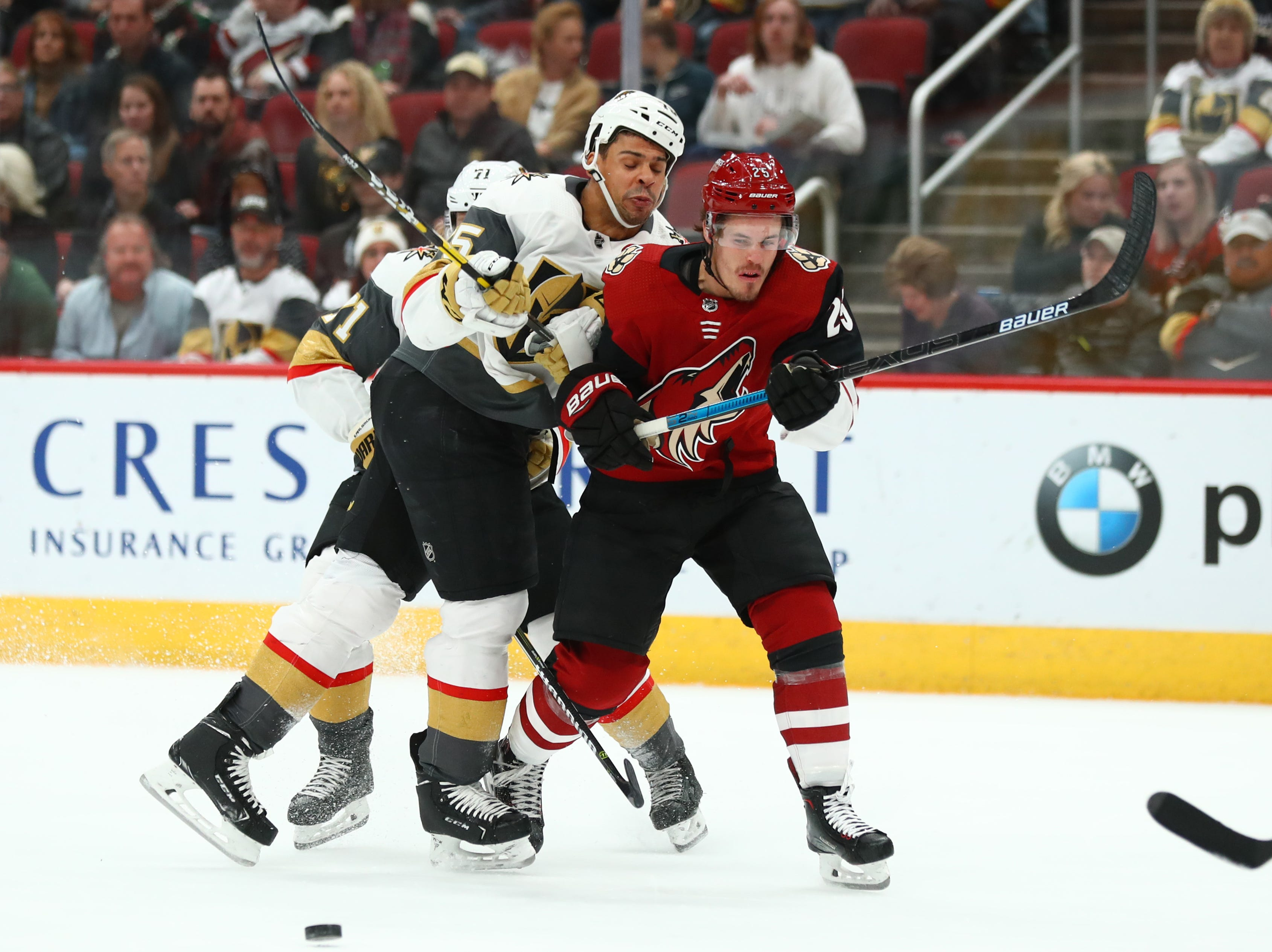 Dec 30, 2018; Glendale, AZ, USA; Arizona Coyotes center Nick Cousins (right) collides with Vegas Golden Knights right wing Ryan Reaves in the first period at Gila River Arena. Mandatory Credit: Mark J. Rebilas-USA TODAY Sports