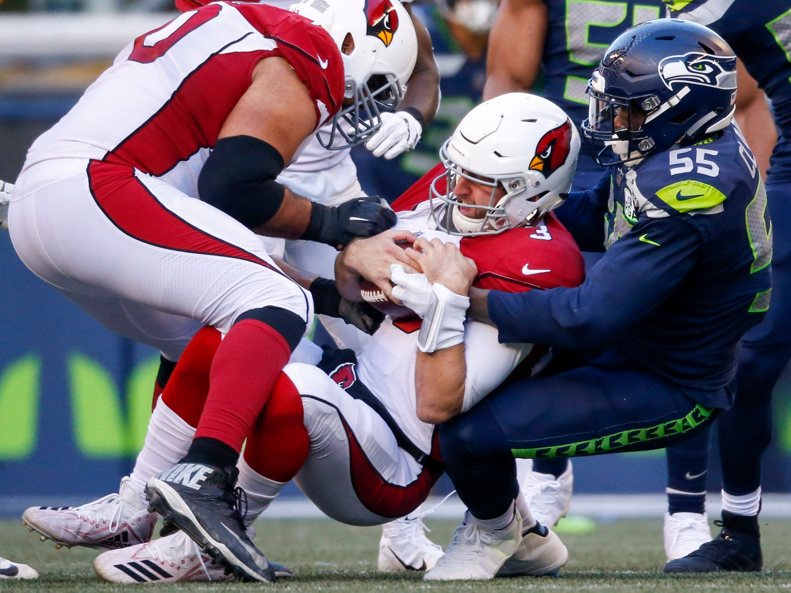Dec 30, 2018; Seattle, WA, USA; Seattle Seahawks defensive end Frank Clark (55) sacks Arizona Cardinals quarterback Josh Rosen (3) during the second quarter at CenturyLink Field. Mandatory Credit: Joe Nicholson-USA TODAY Sports