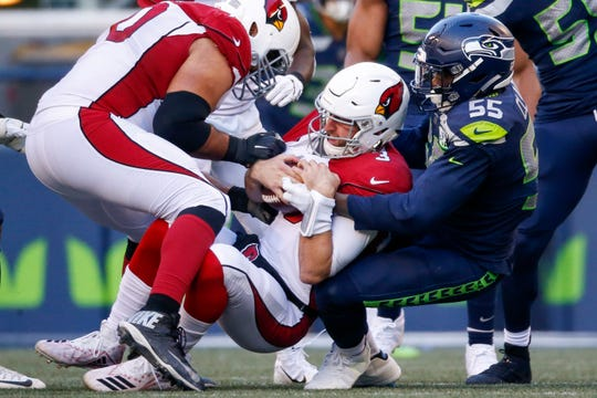 Cardinals rookie quarterback Josh Rosen is sacked by Seahawks defensive end Frank Clark during the second quarter of a game Dec. 30 at CenturyLink Field.
