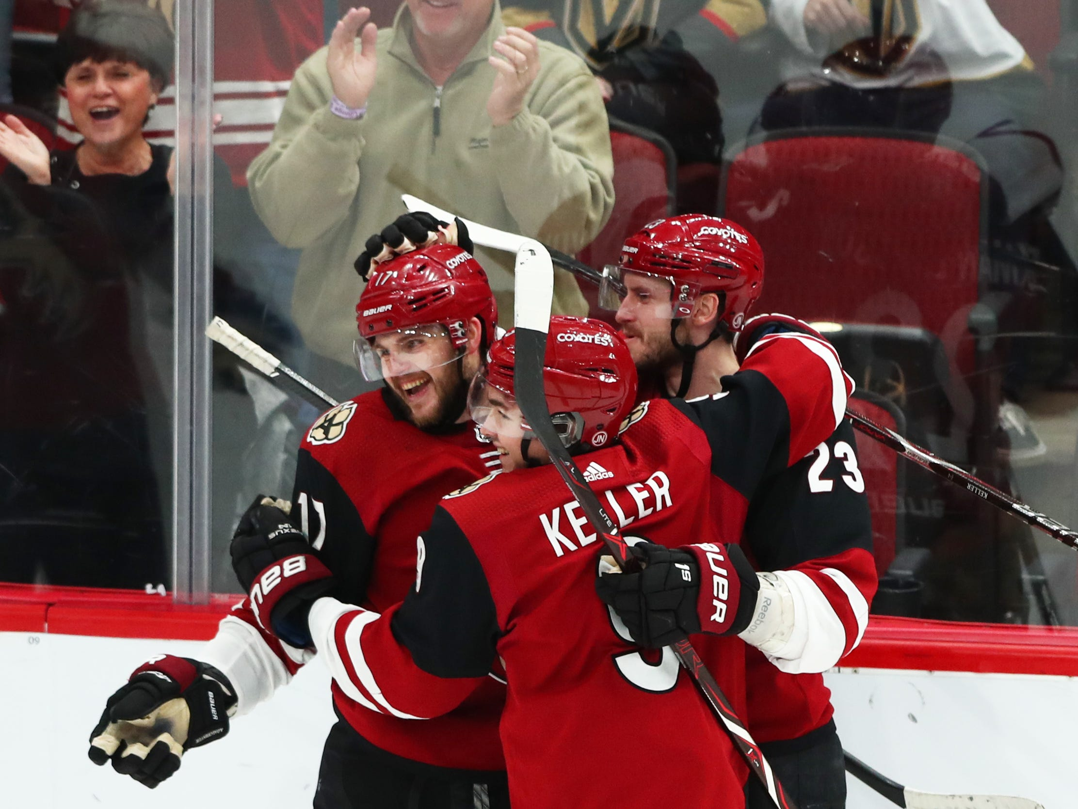 Dec 30, 2018; Glendale, AZ, USA; Arizona Coyotes center Alex Galchenyuk (17) celebrates with teammates Clayton Keller (9) and Oliver Ekman-Larsson (23) after scoring a second period goal against the Vegas Golden Knights at Gila River Arena. Mandatory Credit: Mark J. Rebilas-USA TODAY Sports