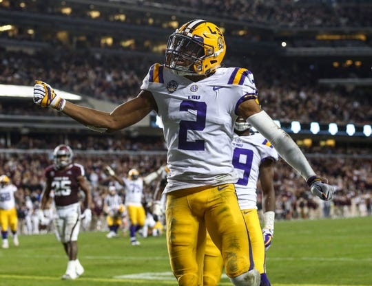 LSU receiver Justin Jefferson celebrates after catching a touchdown pass against Texas A&M during their seven overtime loss 74-72 at Kyle Field.