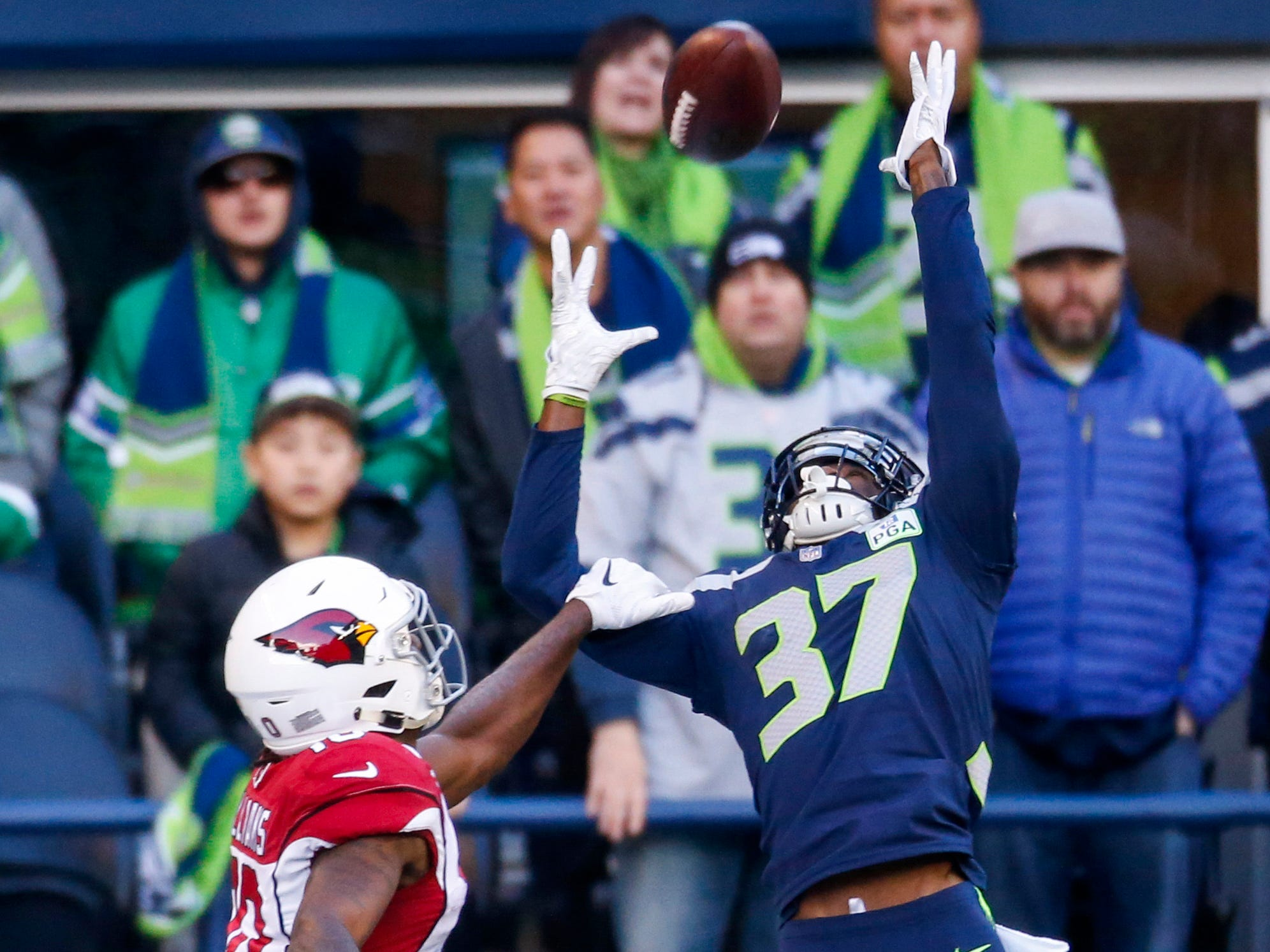 Dec 30, 2018; Seattle, WA, USA; Seattle Seahawks cornerback Tre Flowers (37) defends a pass intended for Arizona Cardinals wide receiver Chad Williams (10) during the first quarter at CenturyLink Field. Mandatory Credit: Joe Nicholson-USA TODAY Sports