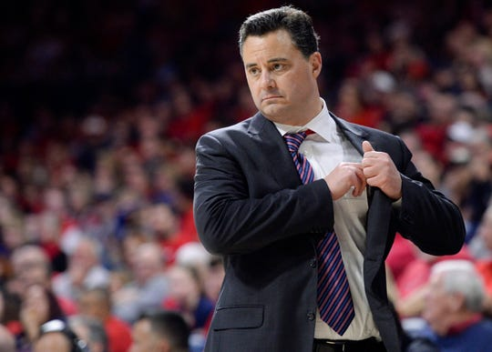 Sean Miller remains the coach of the Arizona Wildcats despite a swirling college basketball bribery scandal.