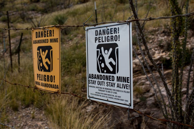 Fencing and danger signs like these near Dragoon are meant to keep people out of abandoned mines.