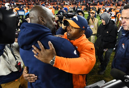 Chargers coach Anthony Lynn greets Broncos coach Vance Joseph following the a game at Broncos Stadium at Mile High.