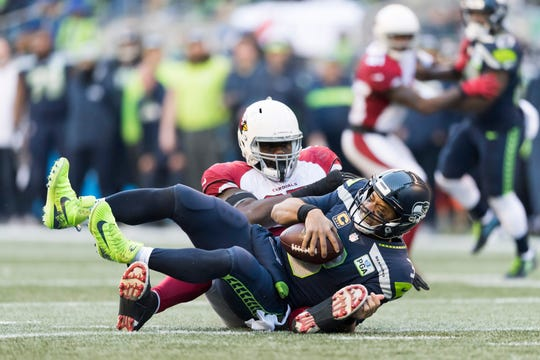Dec 30, 2018; Seattle, WA, USA; Seattle Seahawks quarterback Russell Wilson (3) is sacked by Arizona Cardinals defensive tackle Rodney Gunter (95) during the first half at CenturyLink Field. Mandatory Credit: Steven Bisig-USA TODAY Sports