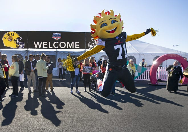 Fiesta Bowl mascot, Spirit, prepares to greet the UCF football team at Sky Harbor International Airport on Dec. 27. UCF will face LSU in the Fiesta Bowl on New Year's Day.